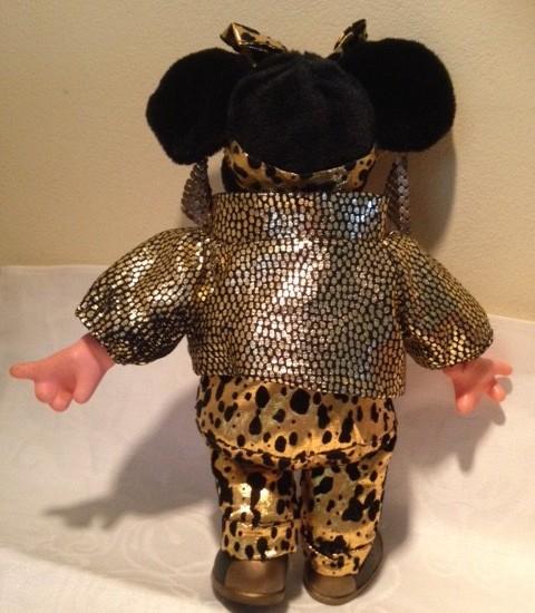 Minnie Mouse als disco girl in goud lame uit de seventies