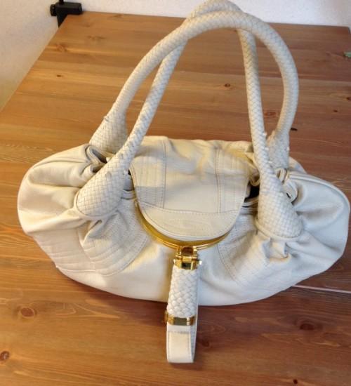 Geen leren, geen used , wel een veilige, lekker zachte damestas