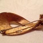 Flinke goud kleurige broche van Monet jaren 1970-1980
