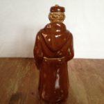 Vintage, oude antieke kruik in de vorm van een monnik met baard