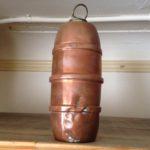 Antiek klein koperen mof of wieg kruikje