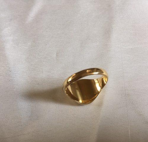 18 karaat geelgouden zegelring met onyx en diamant
