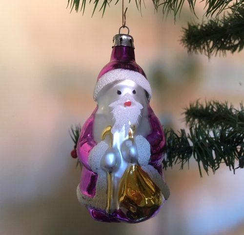 Oude grote kerstman van geblazen glas in goud en paars 2e helft 1900