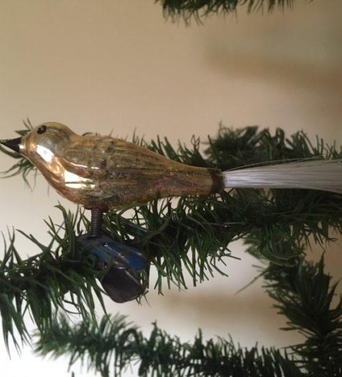 Antieke oude kerst vogel van dun geblazen glas in geel 1e helft vorige eeuw
