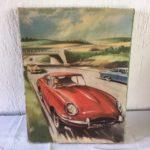Retro houten puzzel van een rode Jaguar E-type uit de sixty's