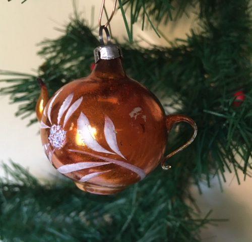 Antieke theepot van vliesdun geblazen glas in koperkleur begin 1900
