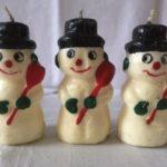 Een Gurley kaars een ondeugende sneeuwpop in zwart, groen en rood uit de sixty's